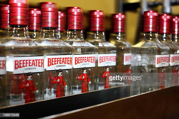 Bottles of Beefeater gin travel along a conveyor belt at the Pernod Ricard SA bottling plant in Dumbarton UK on Friday Nov 19 2010 Pernod Ricard SA...
