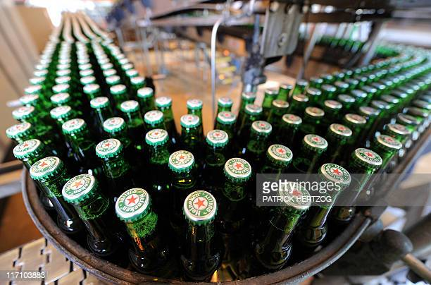 Bottles of beer are seen at the production line of Dutch brewer Heineken factory on June 7 2011 in Schiltigheim eastern France during an official...