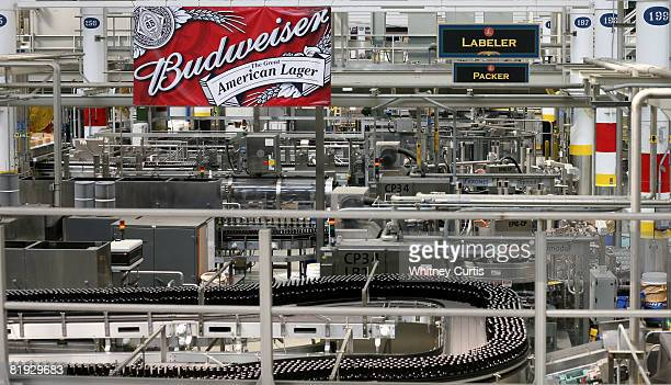 Bottles of beer make their way down the line inside the packaging plant for AnheuserBusch Cos July 14 2008 in St Louis Missouri AnheuserBusch Cos...