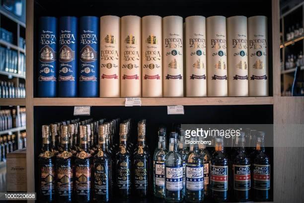 Bottles of Bodega 1800 and Cinco Estrellas brand Venezuelan rums sit on display for sale at a liquor store in the La Castellana neighborhood of...
