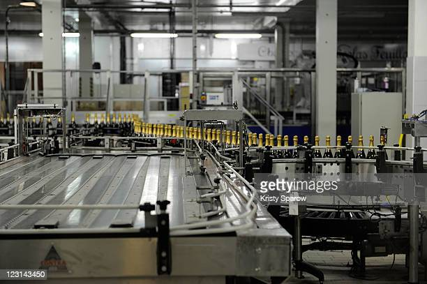 Bottles of champagne are processed at the Nicolas Feuillatte champagne processing facility on August 31 2011 in Epernay France
