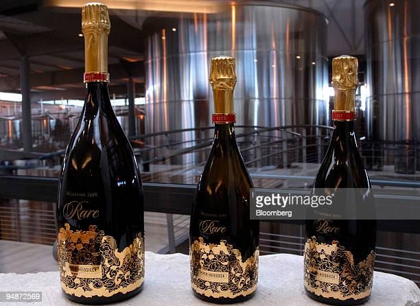 Bottles of champagne sit on display at the Piper-Heidsieck champagne factory, owned by Remy-Cointreau, in Reims, France, on Monday, July 21, 2008....