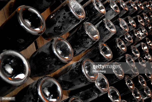 Bottles of champagne sits on display in the cellars of the Piper-Heidsieck champagne factory, owned by Remy-Cointreau, in Reims, France, on Monday,...