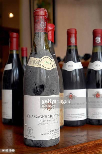 Bottles of Chassagne-Montrachet Clos Saint Jean sit on a table at the los Saint Jean vineyard, in the Burgundy village of Chassagne-Montrachet,...
