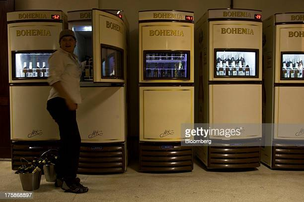Bottles of Cia de Bebidas das Americas Bohemia brand beer are transferred from a refrigerator to buckets at a restored Bohemia brewery in Petropolis...
