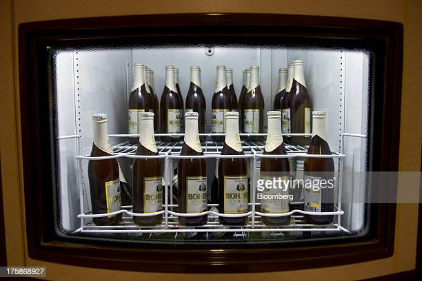 Bottles of Cia de Bebidas das Americas Bohemia brand beer sit in a refrigerator at a restored Bohemia brewery in Petropolis Brazil Sunday Aug 4 2013...