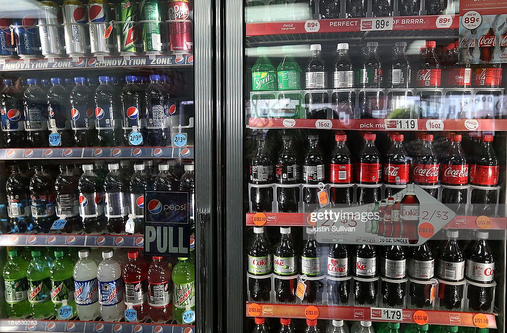 Bottles of Coca Cola and Pepsi soft drinks sit in a cooler at a 76 gas station on March 25, 2013 in San Francisco, California. According to a report by Beverage Digest, sales of carbonated soft drinks in the United States fell 1.2 percent in 2012 to 9.17 billion cases.