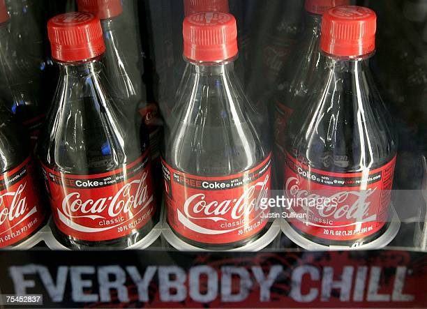 Bottles of Coca Cola are seen on a shelf at the Marina Market July 17 2007 in San Francisco California Coca Cola Company reported an increase in...