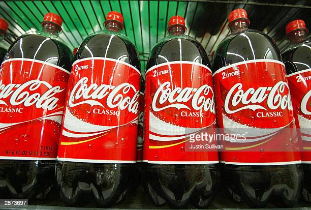 Bottles of CocaCola are seen on the shelf at Tower Market January 16 2004 in San Francisco California CocaCola is being investigated by US regulators...