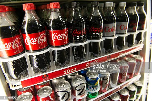 Bottles of CocaCola Co soda products are displayed in a store in San Francisco California US on Wednesday Feb 6 2013 The CocaCola Co is scheduled to...