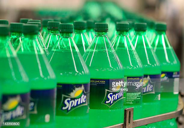 Bottles of CocaCola Co's Sprite move along a conveyor belt at the company's Swire bottling plant in Salt Lake City Utah US on Tuesday April 24 2012...