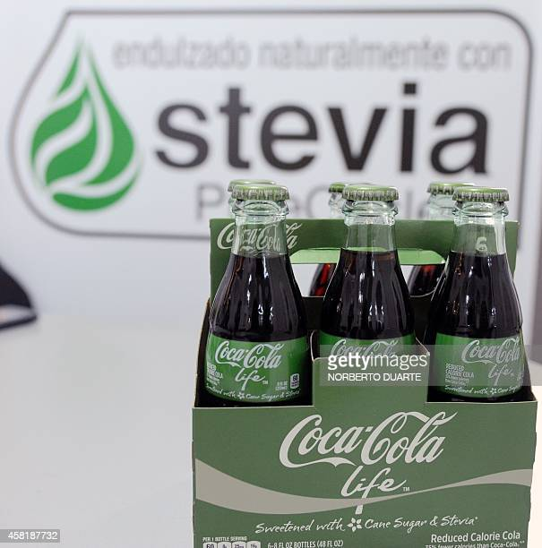 Bottles of 'CocaCola life' partially sweetened with stevia on October 31 2014 in Asuncion Following the approval by the US and European health...