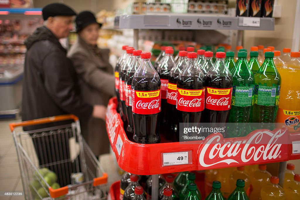 Bottles of Coca-Cola, Sprite and Fanta, produced by U.S. manufacturer Coca-Cola Co., sit on a branded display stand inside a Dixy supermarket operated by OAO Dixy Group in Moscow, Russia, on Tuesday, April 8, 2014. Suppliers suffering from ruble depreciation this quarter are urging retailers to increase prices. Photographer: Andrey Rudakov/Bloomberg via Getty Images