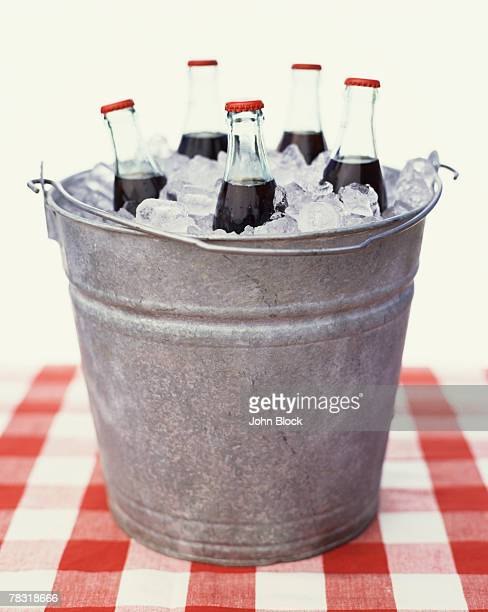 Bottles of Cola in Ice Bucket