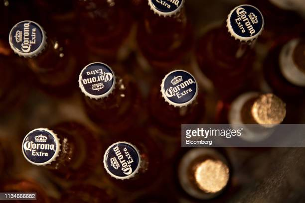Bottles of Constellation Brands Inc Corona beer sit in the cooler of a bar in Ottawa Illinois US on Tuesday April 2 2019 Constellation Brands is...