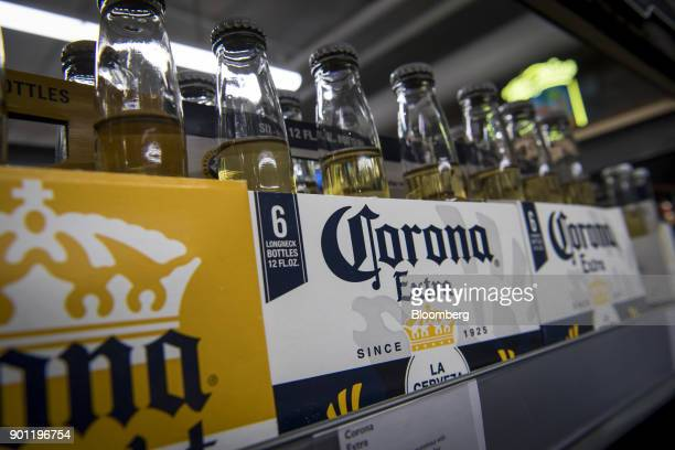 Bottles of Constellation Brands Inc Corona beer sit on display for sale inside a BevMo Holdings LLC store in Walnut Creek California US on Wednesday...