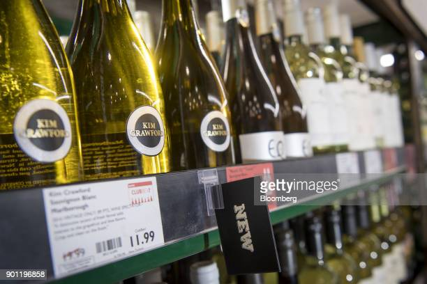 Bottles of Constellation Brands Inc Kim Crawford Sauvignon Blanc wine sit on display for sale inside a BevMo Holdings LLC store in Walnut Creek...
