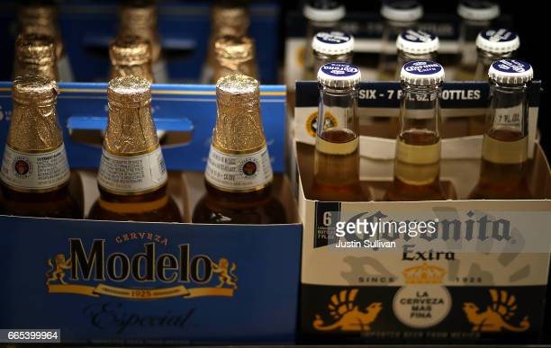 Bottles of Corona and Modelo beer are displayed on the a shelf at a supermarket on April 6 2017 in San Rafael California Constellation Brands maker...