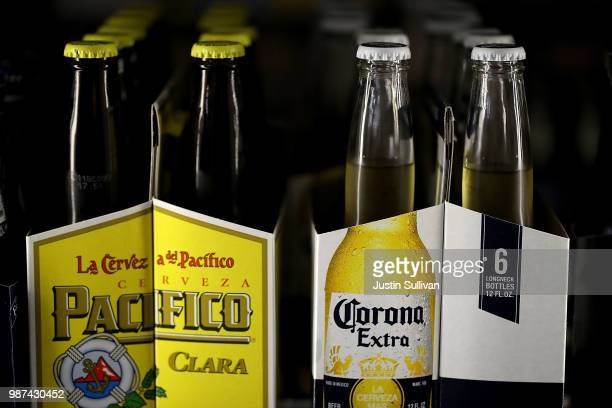 Bottles of Corona and Pacifico beer are displayed in a cooler at Marin Beverage Outlet on June 29 2018 in San Rafael California Shares of...