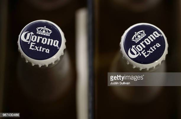 Bottles of Corona are displayed in a cooler at Marin Beverage Outlet on June 29 2018 in San Rafael California Shares of Constellation Brands fell 5...