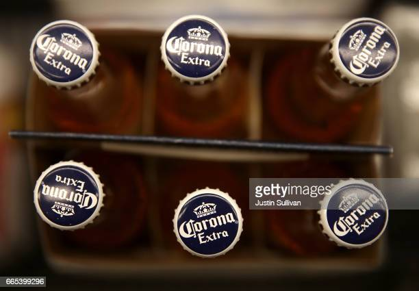 Bottles of Corona beer are displayed on the a shelf at a supermarket on April 6 2017 in San Rafael California Constellation Brands maker of popular...