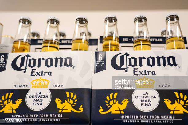 Bottles of Corona Extra seen in a Target superstore Corona Extra Beer is a pale lager produced by Cervecería Modelo in Mexico