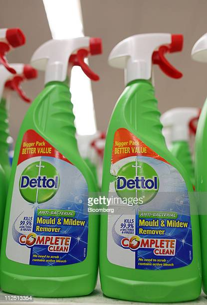 Bottles of Dettol disinfectant produced by Reckitt Benckiser Group Plc sit on display at a Tesco supermarket in London UK on Tuesday April 19 2011...