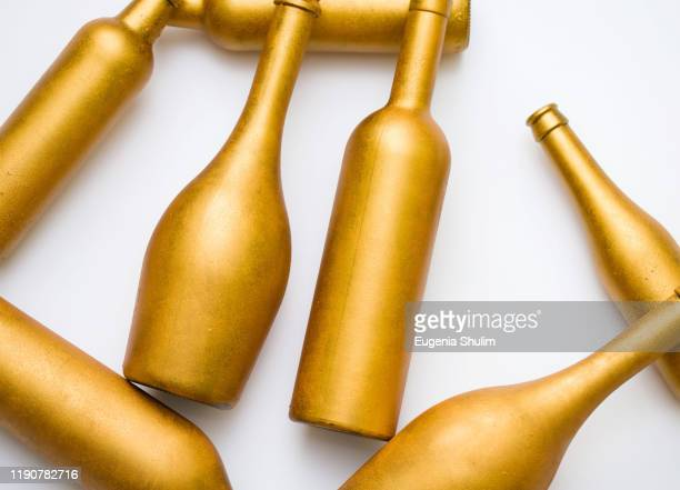 bottles different sizes gold color isolated