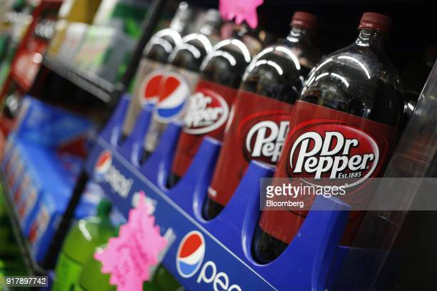 Bottles of Dr Pepper brand soda sit on display for sale at a convenience store in Bagdad Kentucky US on Sunday Feb 11 2018 Dr Pepper Snapple Group...