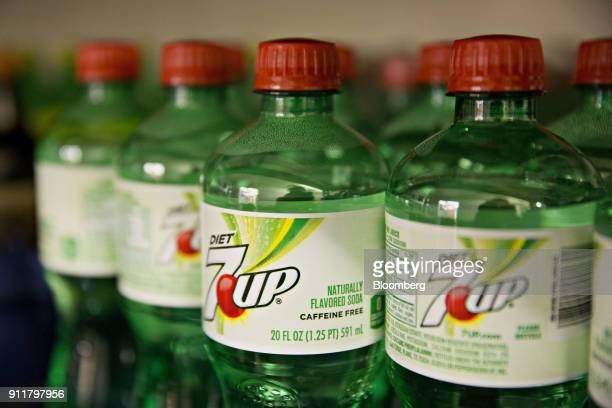 Bottles of Dr Pepper Snapple Group Inc 7Up brand soda sits on display in a convenience store in Tiskilwa Illinois US on Tuesday April 26 2016 Keurig...