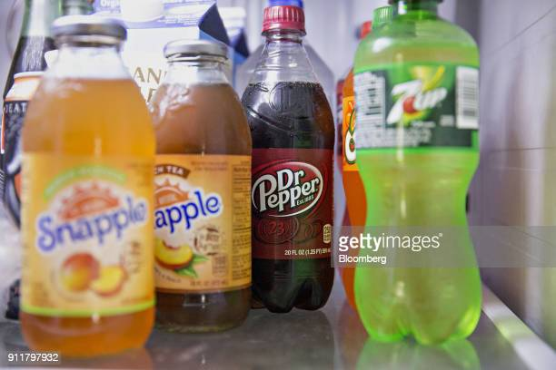 Bottles of Dr Pepper Snapple Group Inc beverages including Snapple Dr Pepper and 7Up are arranged for a photograph in Tiskilwa Illinois US on Tuesday...