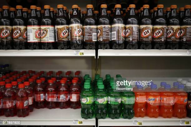 Bottles of Dr Pepper Snapple Group Inc brand soda sit on display for sale at a grocery store in Louisville Kentucky US on Tuesday Feb 13 2018 Dr...