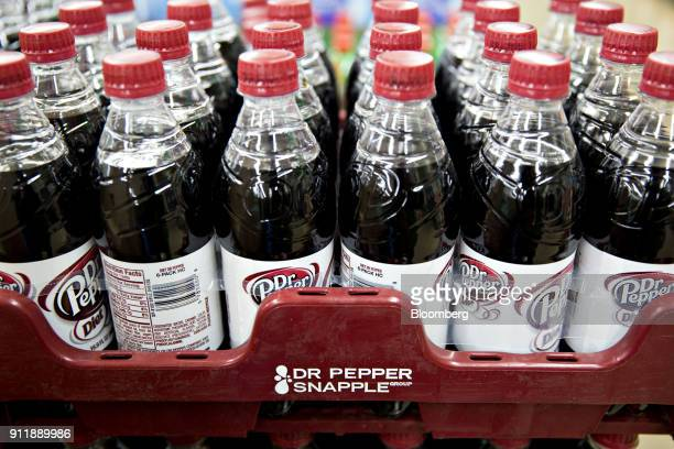 Bottles of Dr Pepper Snapple Group Inc Diet Dr Pepper brand soda are displayed for sale at a supermarket in Princeton Illinois US on Monday Jan 29...