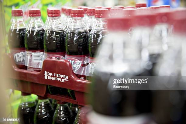 Bottles of Dr Pepper Snapple Group Inc Dr Pepper brand soda are displayed for sale at a supermarket in Princeton Illinois US on Monday Jan 29 2018...