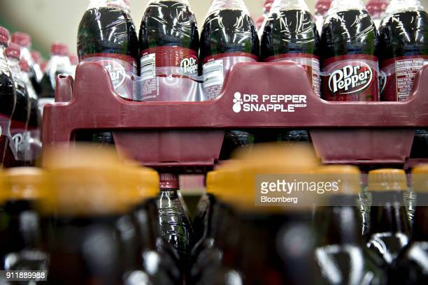 Bottles of Dr Pepper Snapple Group Inc Dr Pepper brand soda sit on display for sale at a supermarket in Princeton Illinois US on Monday Jan 29 2018...