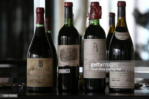 Bottles of fake wine Musigny Cuvee Vielles Vignes Domaine Comte Georges de Vogue ChambolleMuscigny 1949 and Chateau LafiteRothschild 1961 and Grand...
