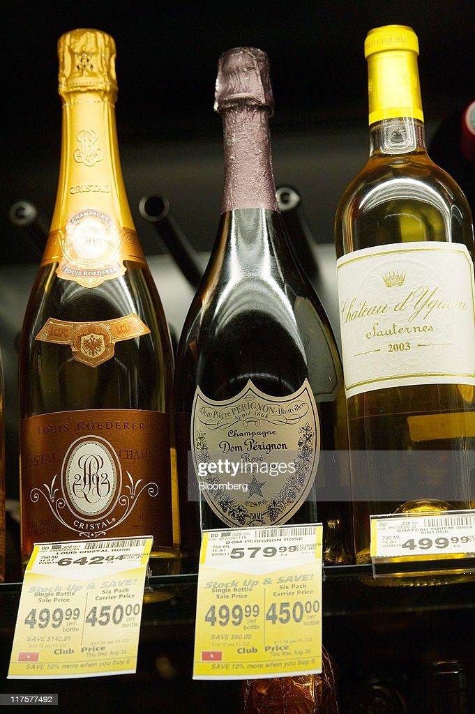 Bottles of fine wine and champagne are displayed for sale at a