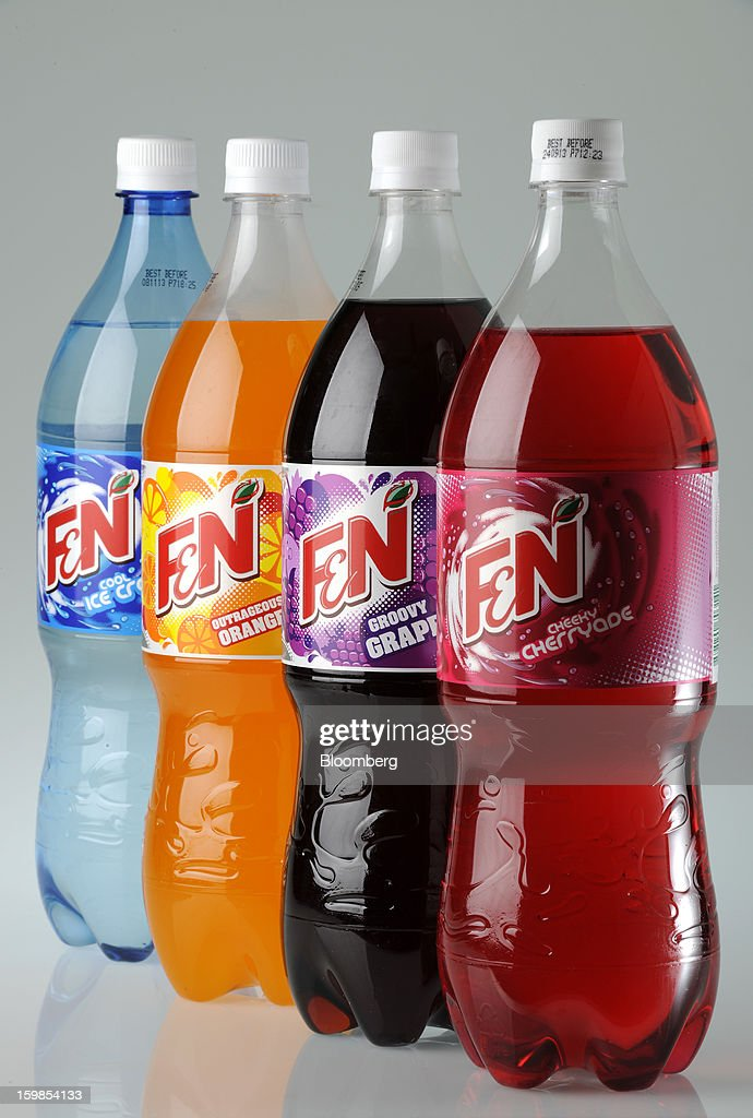 Bottles of Fraser & Neave Ltd.'s F&N sparkling drink in various flavors are arranged for a photograph in Singapore, on Monday, Jan. 21, 2013. Thailand's richest man came closer to winning control of Fraser & Neave after a rival group failed to top his S$13.8 billion ($11.2 billion) offer for the 130-year-old property and beverage company. Photographer: Munshi Ahmed/Bloomberg via Getty Images