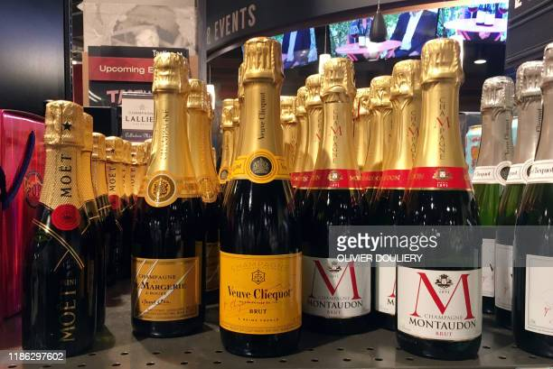 Bottles of French champagne are displayed for sale in a liquor store on December 3, 2019 in Arlington, Virginia. - The United States on December 2,...