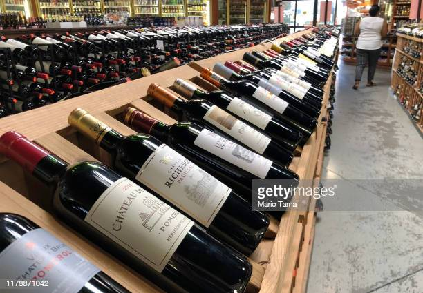 Bottles of French wine are displayed for sale in a liquor store on October 3 2019 in Los Angeles California The Trump administration has slapped $75...