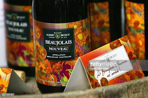 Bottles of French winemaker Albert Bichot's Beaujolais Nouveau 2004 are displayed at George Hinawi's liquor merchants around midnight between...