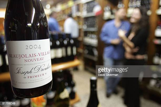 Bottles of French winemakers Joseph Drouhin's Beaujolais Nouveau 2004 are displayed at George Hinawi's liquor merchants around midnight between...