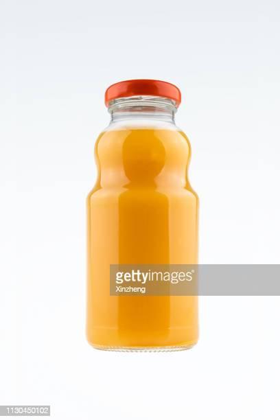 bottles of fruit juice - orange juice stock pictures, royalty-free photos & images