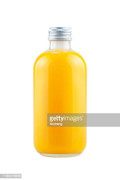 bottles of fruit juice - botella fotografías e imágenes de stock