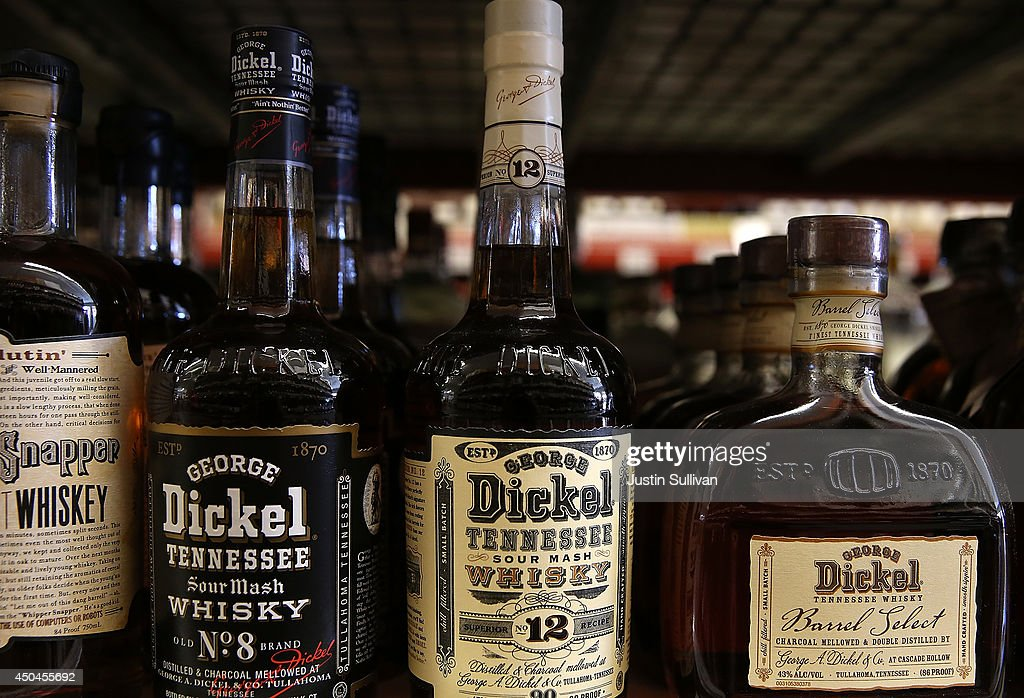 Bottles of George Dickel whiskey are displayed on a shelf at Marin Beverage Outlet on June 11, 2014 in San Rafael, California. A battle is heating up between the owners of rival whiskey brands Jack Daniel's and George Dickel who are fueding over who can label their product as authentic Tennessee style whiskey. Jack Daniel's distills and ages their whiskey in Tennessee while George Dickel distills in Tennessee and ages in Kentucky.
