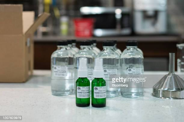 Bottles of hand sanitizer solution made from distilled alcohol byproducts sit on a counter at the Glass Distillery in the SoDo neighborhood of...
