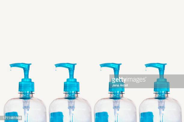 bottles of hand sanitizers - hand sanitiser stock pictures, royalty-free photos & images