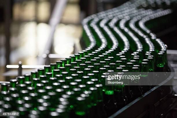 Bottles of Heinken beer travel along the production line at the Heineken NV brewery in Saint Petersburg Russia on Wednesday Nov 18 2015 Heineken...