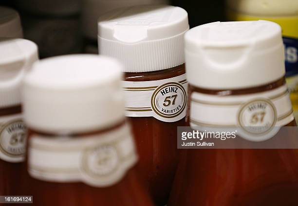 Bottles of Heinz ketchup are displayed on a shelf at Bryan's Market on February 14 2013 in San Francisco California Billionaire investor Warren...