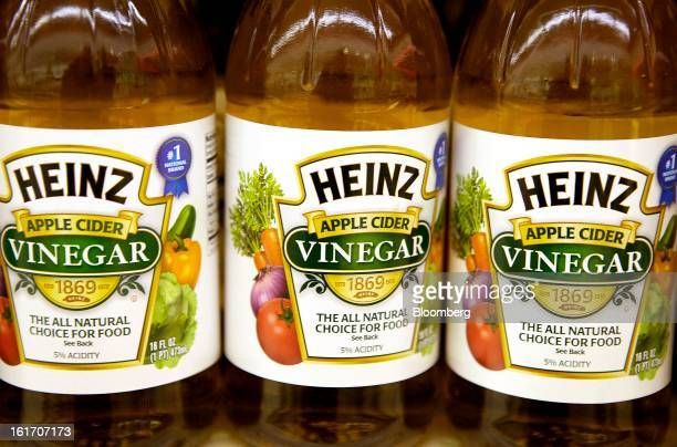 Bottles of HJ Heinz Co apple cider vinegar are displayed on a shelf for sale at grocery store in Pittsburgh Pennsylvania US on Thursday Feb 14 2013...